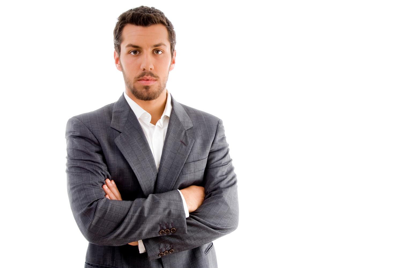 portrait of businessman with folded hands - KOHLEX